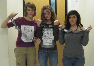 Willow Parsons, McClain Houston and Megan Milla dress up to protest the circus.