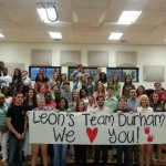 Passionate students hold up a banner in support of Rod Durham's Extreme Weight Loss journey.