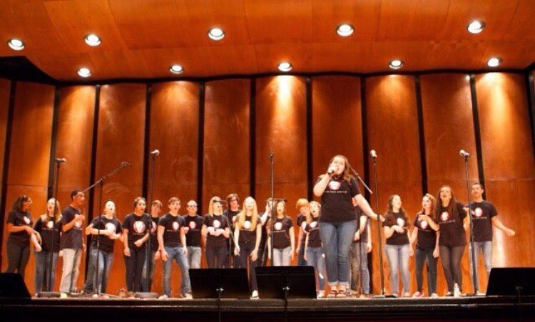 Senior and section leader Hannah Prasse sings at last year's mane event concert.